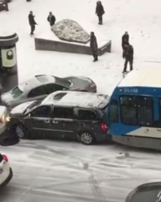 Buses, Cars, Police Crash On Icy Road (Video) Promo Image
