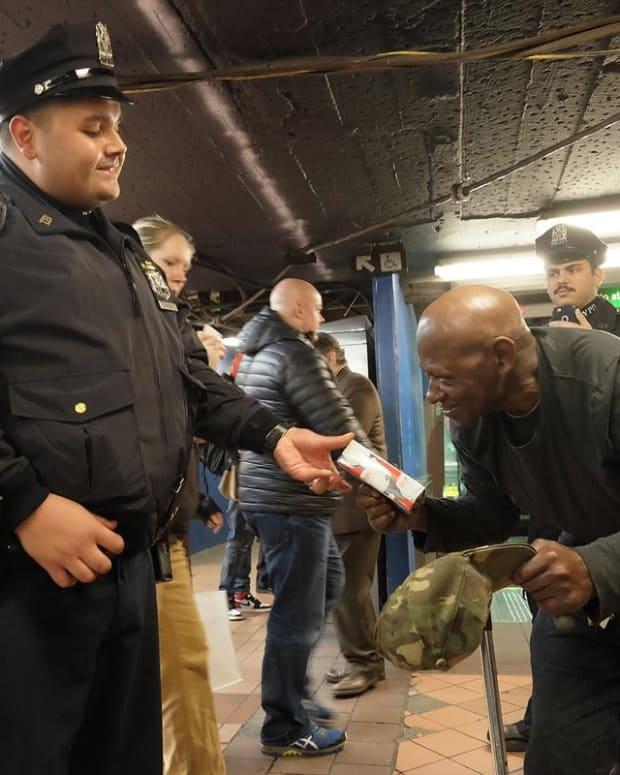 Cop Gives Diabetic Homeless Man A Chrismas Gift Promo Image