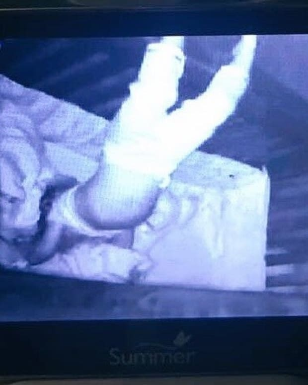 Babysitter Scared By What's On Baby Monitor (Photo) Promo Image