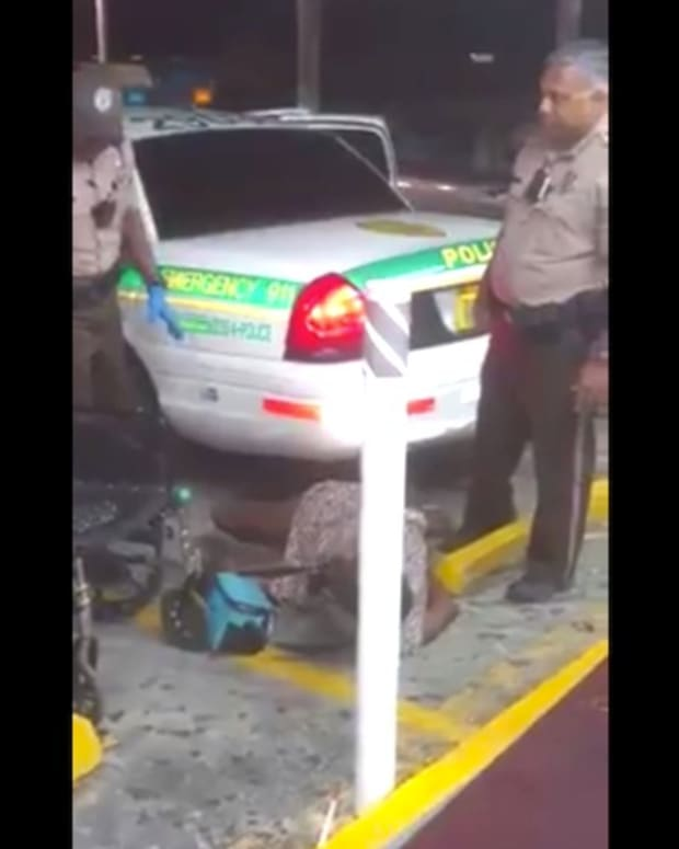 Police Handcuff Legless Woman, Drop Her On Ground (Video) Promo Image