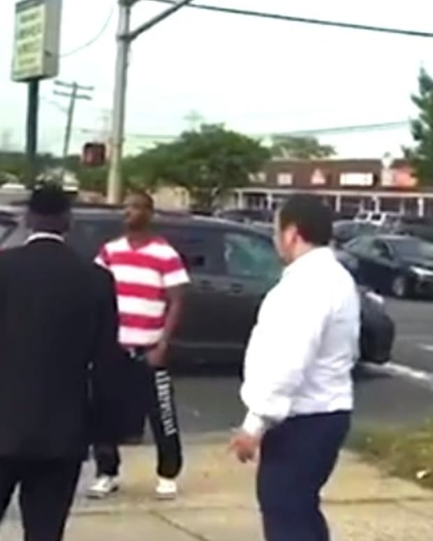 Angry Motorist Goes On Tirade At Bystanders (Video) Promo Image