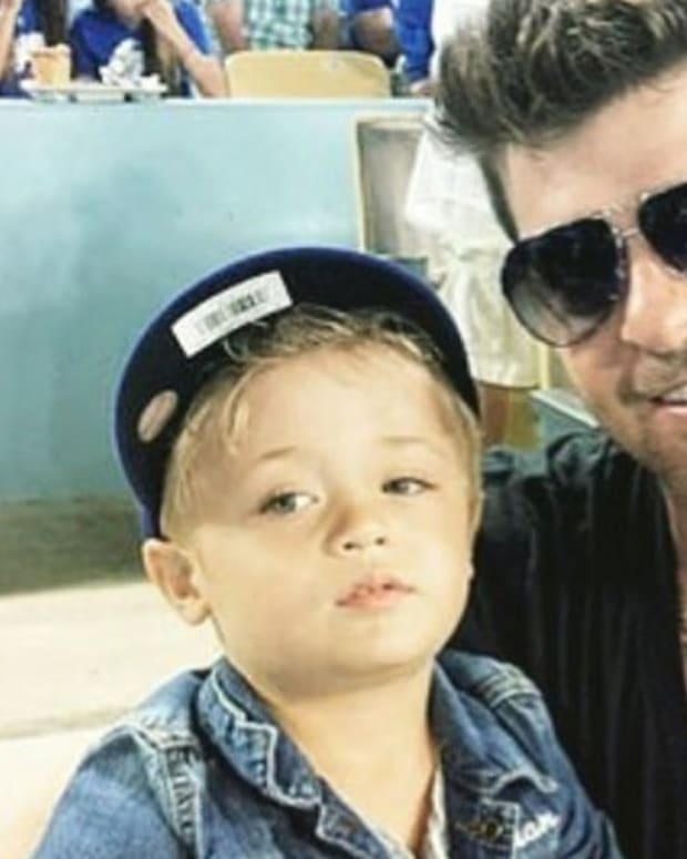 Robin Thicke's Ex-Wife Accuses Him Of Child Abuse Promo Image