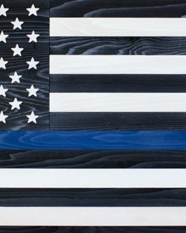Here's What That Flag With A Blue Stripe Means (Photo) Promo Image