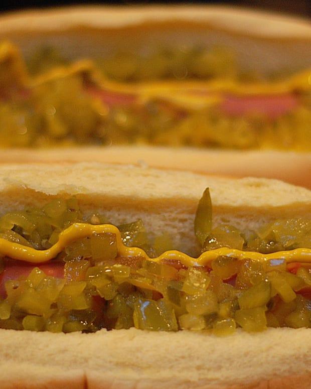 Dog Owner Finds Hot Dog Filled With Shards In Yard (Photo) Promo Image