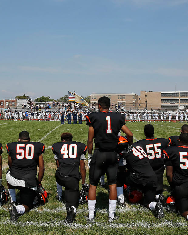 High School Football Team Kneels During National Anthem Promo Image