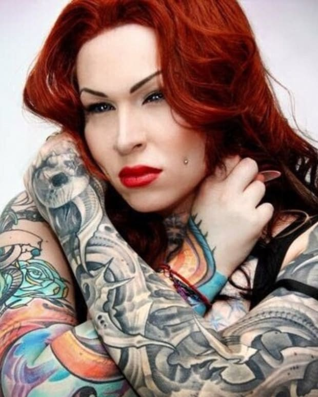 Woman Tattoos Her Eyes Purple (Photos) Promo Image