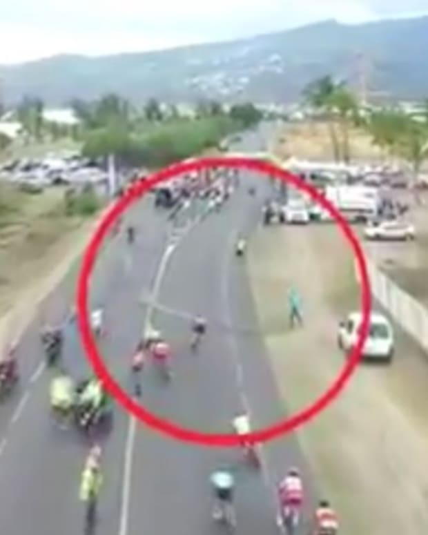 Angry Spectator Causes Crashes During Bike Race (Video) Promo Image