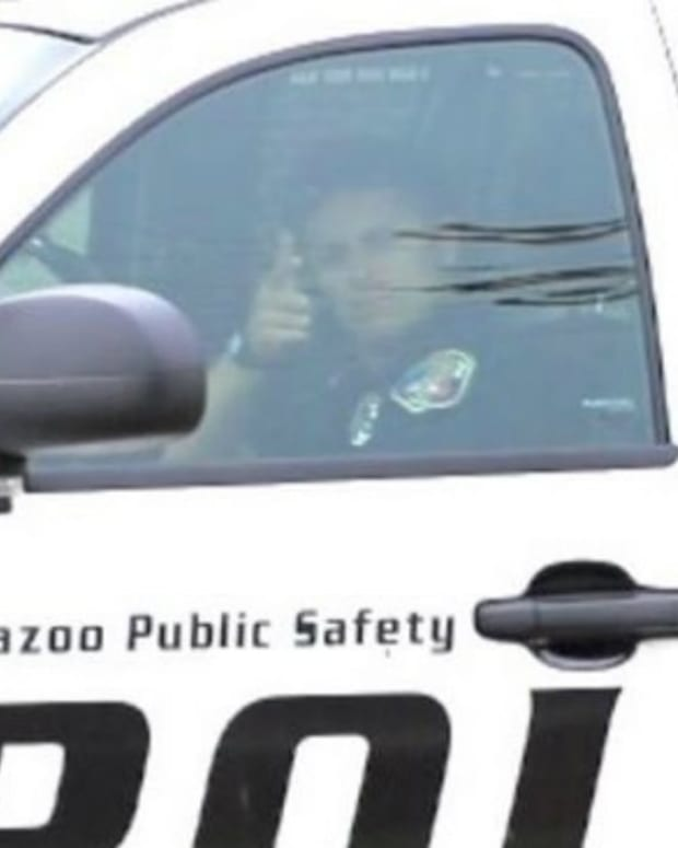 Officer Under Fire For Hand Gesture (Photo) Promo Image