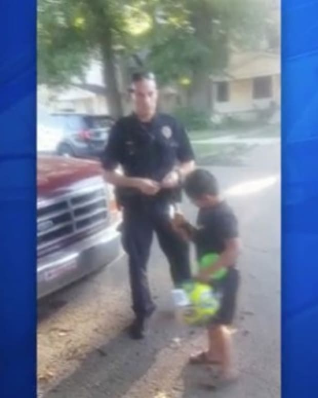 Officer's Act Of Kindness Makes Young Boy's Day Promo Image