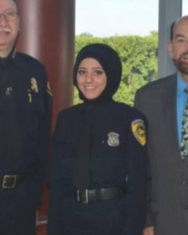 Police Department Hires First Officer To Wear Hijab Promo Image