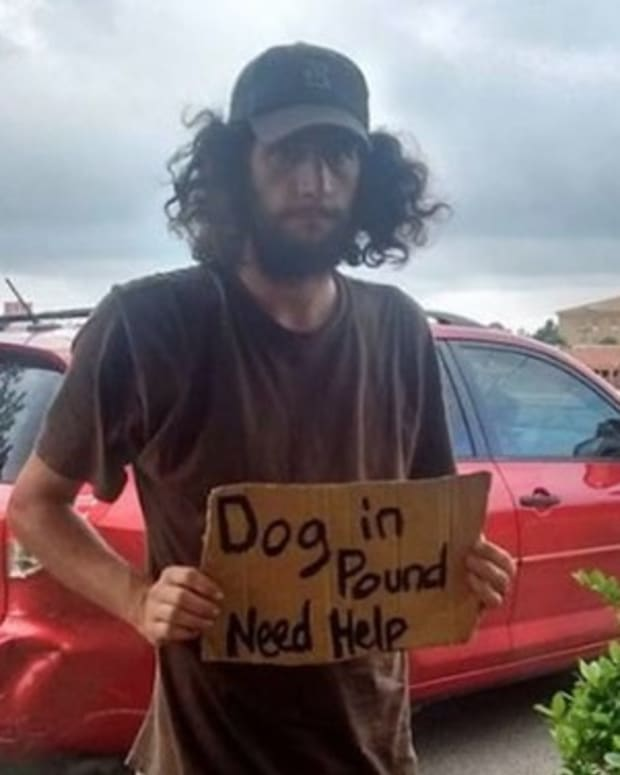 Mom Notices Homeless Man Holding Sign In Walmart Lot, Freezes When She Sees What It Says (Photo) Promo Image
