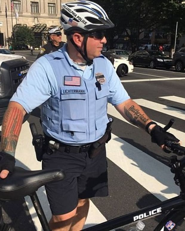 Photo Of Cop With Questionable Tattoos Goes Viral (Photos) Promo Image