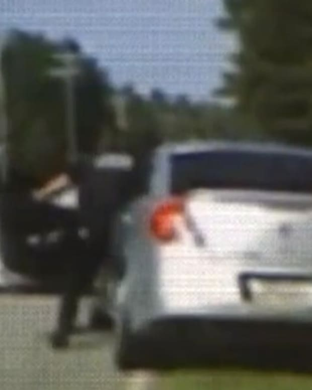 Woman Runs Over Police Officer With Car (Video) Promo Image