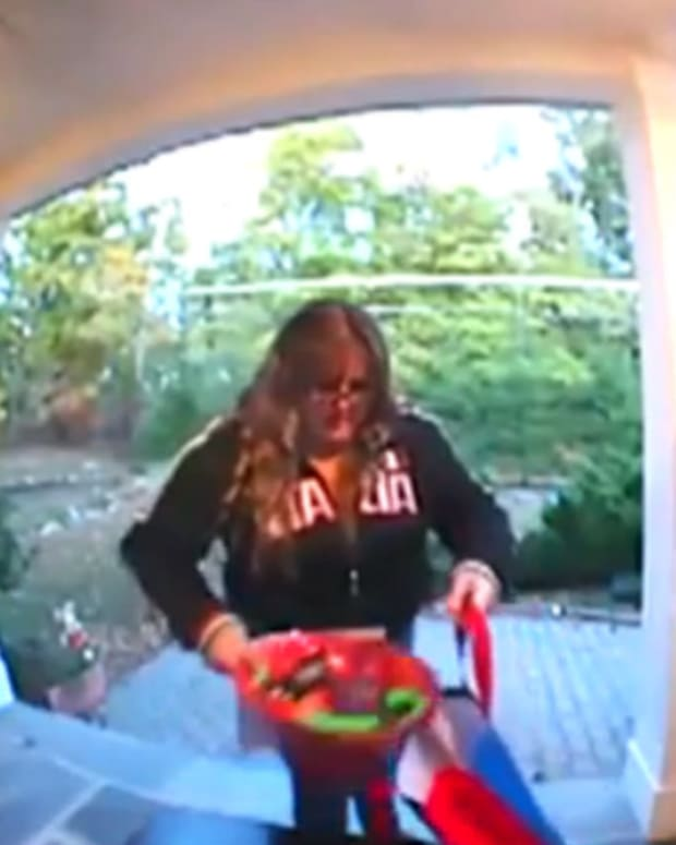 Woman Caught On Camera Stealing Halloween Candy (Video) Promo Image