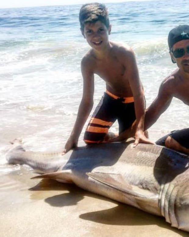 13-Year-Old Boy Catches 250-Pound Shark Promo Image