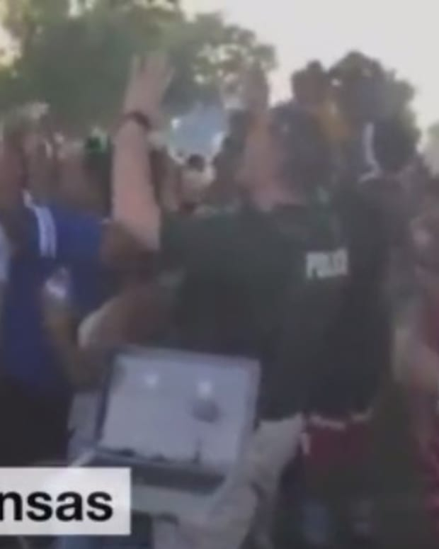 Police Officer Dances With Black Lives Matter Activists (Video) Promo Image