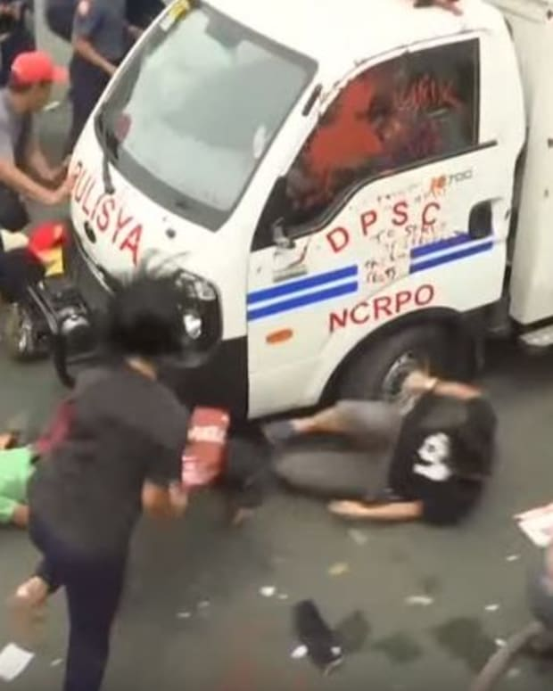 Police Van Rams Anti-US Protesters In Philippines (Video) Promo Image