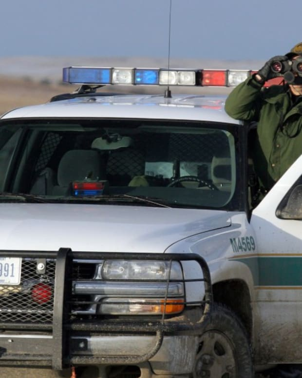 Border Agents Raid Humanitarian Camp, Arrest Immigrants Promo Image
