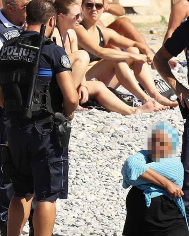 Burkini Ban: Police Make Woman Remove Clothing On Beach Promo Image