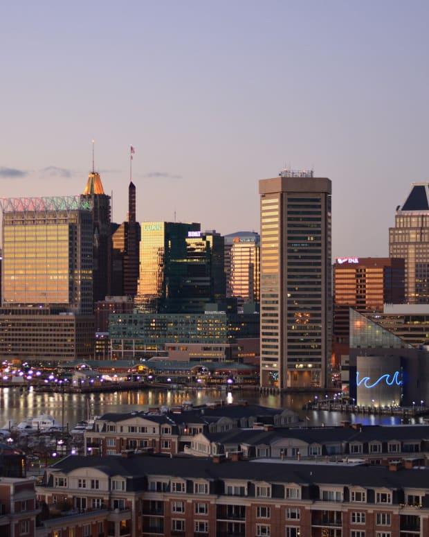 Baltimore Tears Down Confederate Statues Overnight Promo Image