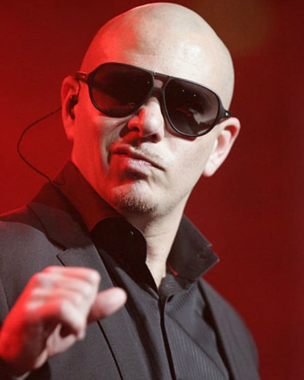 Pitbull Sends Plane For Puerto Rico Cancer Patients Promo Image