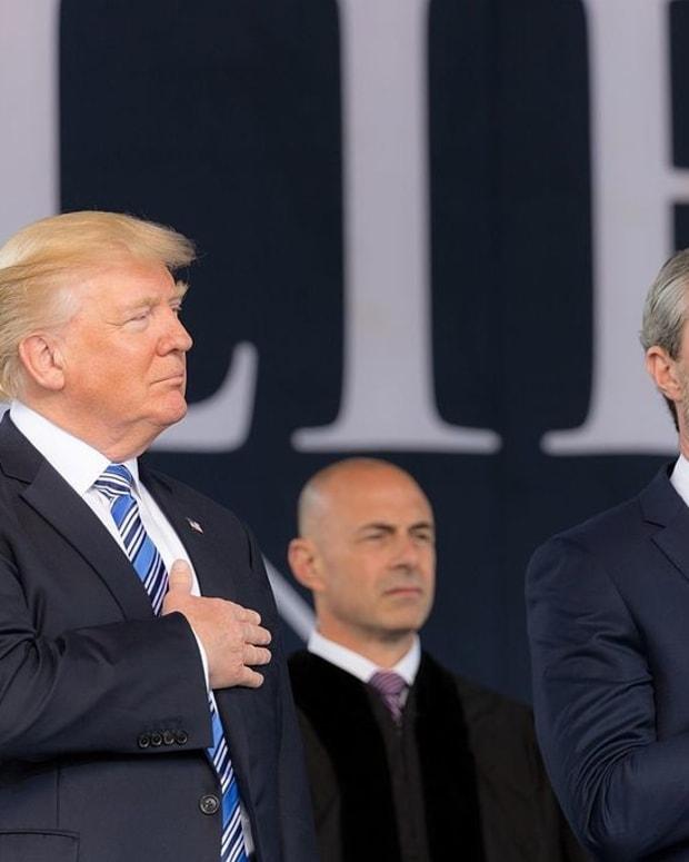 Trump Says Apple Will Build US Plants Promo Image