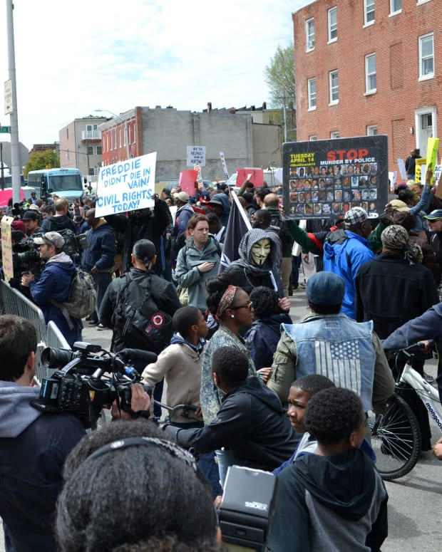 DOJ Drops Charges Against Officers In Freddie Gray Case Promo Image
