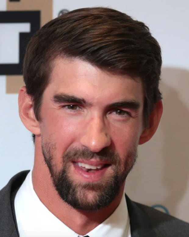 Viewers Furious: Michael Phelps Races Simulated Shark (Video) Promo Image