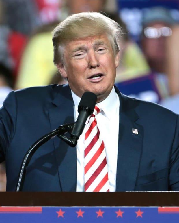 Trump Drops By Christmas Party At Mar-a-Lago (Photos) Promo Image