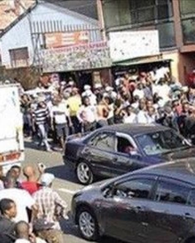 Crowd Gathers As Man Gets Stuck Inside Married Lover Promo Image