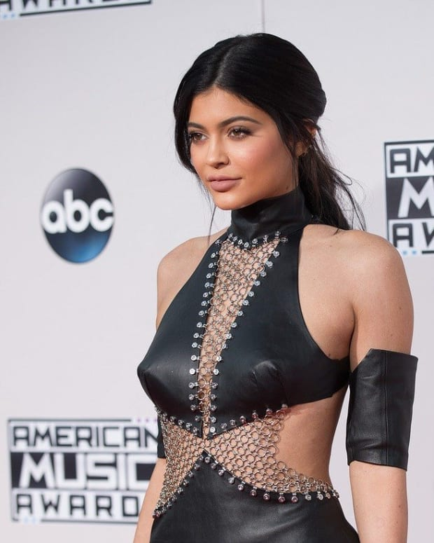 Kylie Jenner Covers Up Baby Bump (Photos) Promo Image