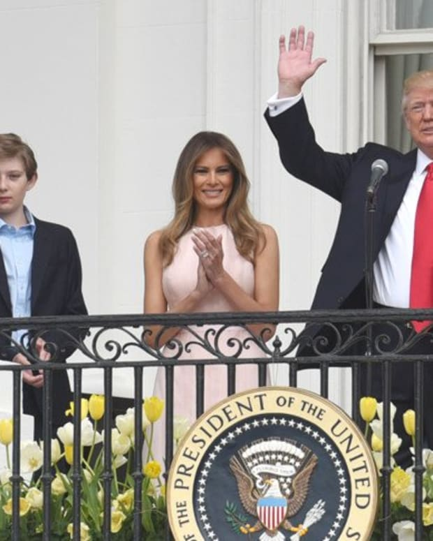 Melania Wears Sunglasses At Night As First Family Returns To D.C. (Photos) Promo Image