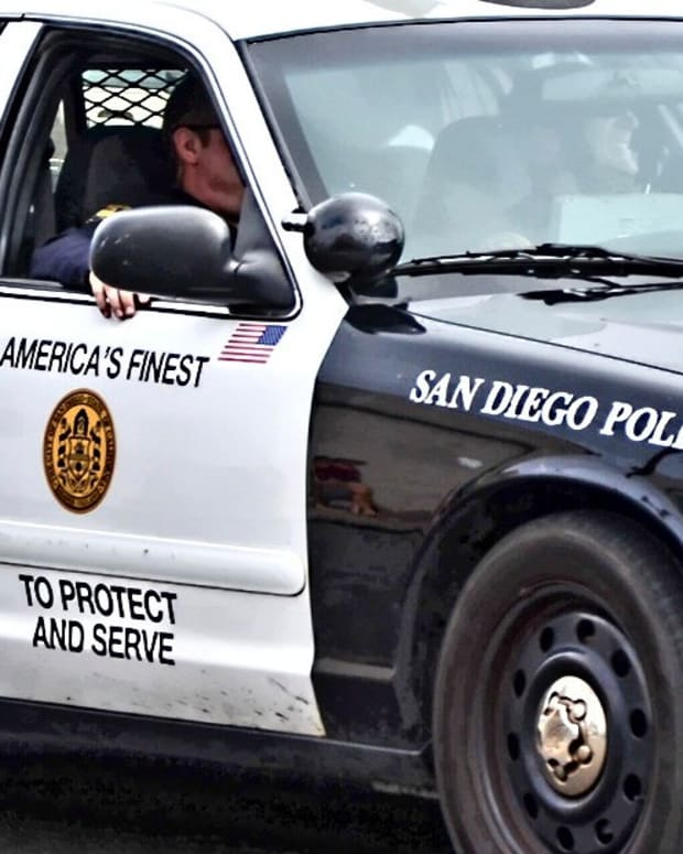 San Diego Cops Allow Dog To Bite Handcuffed Black Man (Video) Promo Image