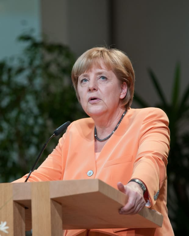 Angela Merkel Rejects Refugee Limits For Germany Promo Image