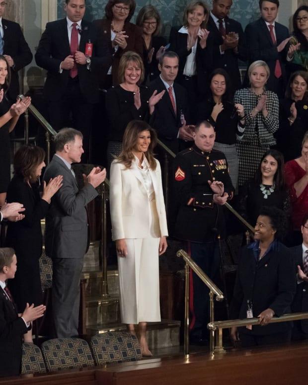 Melania Trump Wears White Amid All Black (Photos) Promo Image