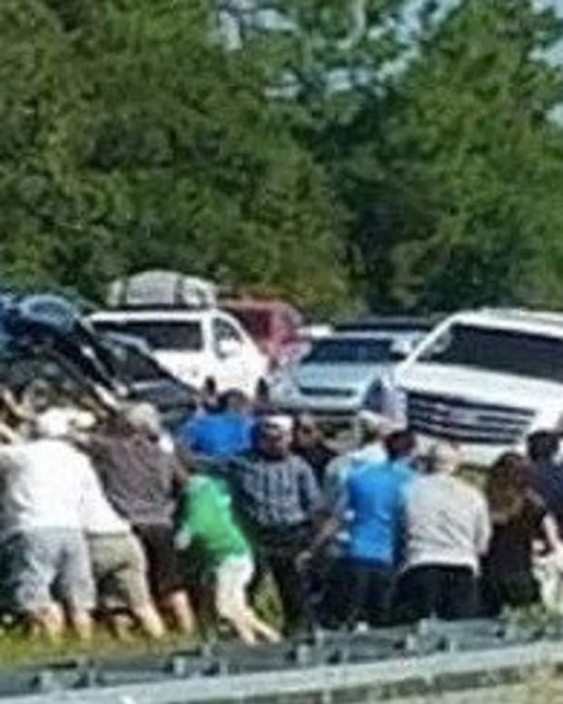 Woman Snaps Photo Of Horrible Car Wreck After She Notices What's In Crowd Promo Image