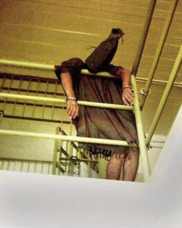 Abu Ghraib Prisoner Handcuffed to Railing