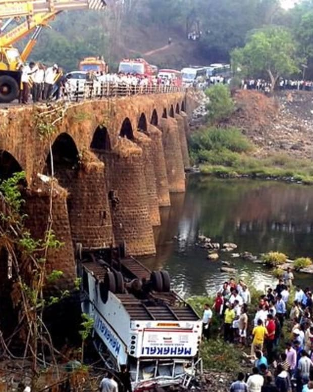 At least 37 dead, 15 injured when Indian bus falls from bridge.