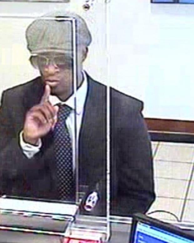 Cross-dressing bank robber?