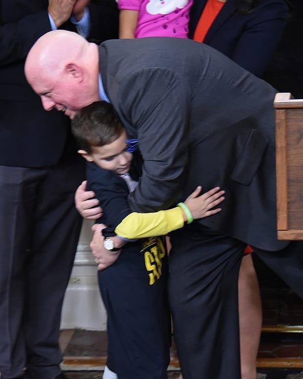 Gov. Larry Hogan hugging Andrew Oberle