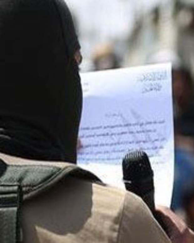 ISIS Executes Young Child For 'Cursing Divinity' Promo Image