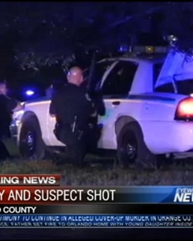cop car at scene of shootout during arrest