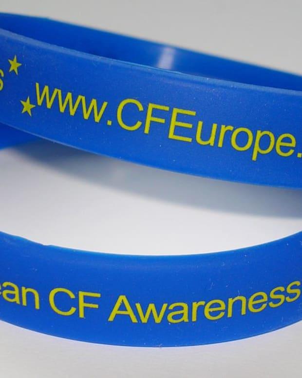Wristbands promoting awareness of cystic fibrosis.