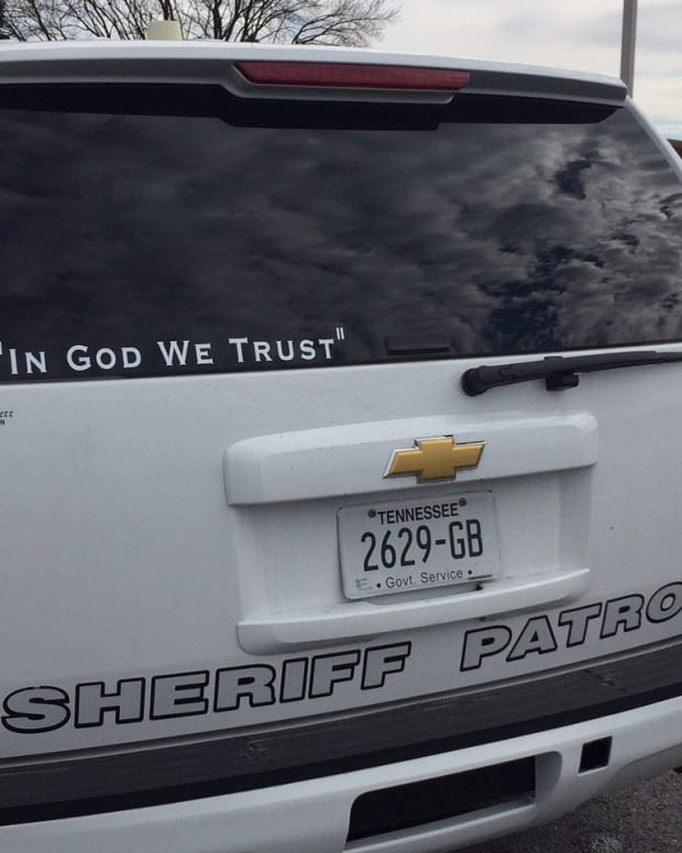 'In God We Trust' On A Police Vehicle.