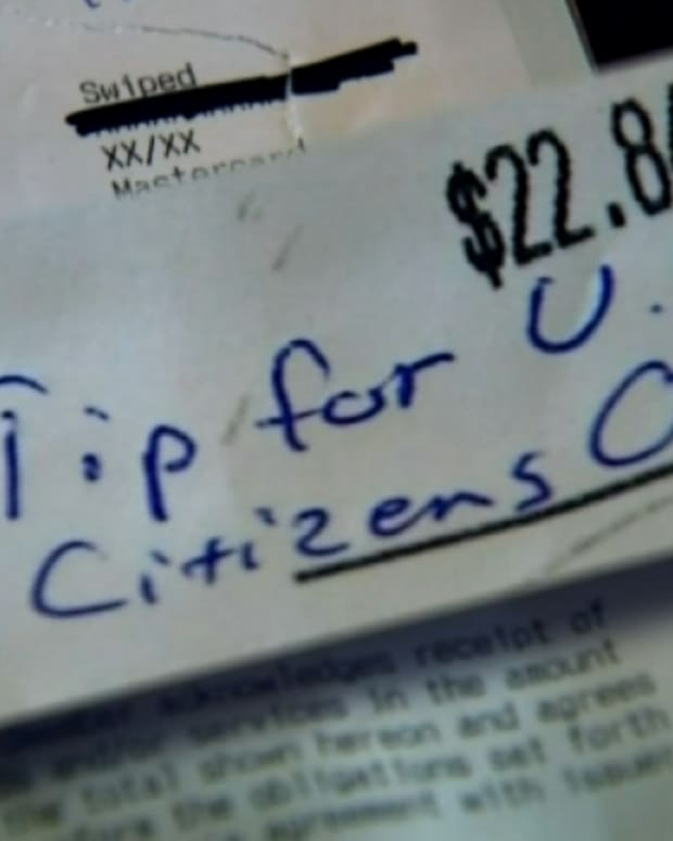 'Tip for U.S. Citizens Only' written on receipt at Thai restaurant