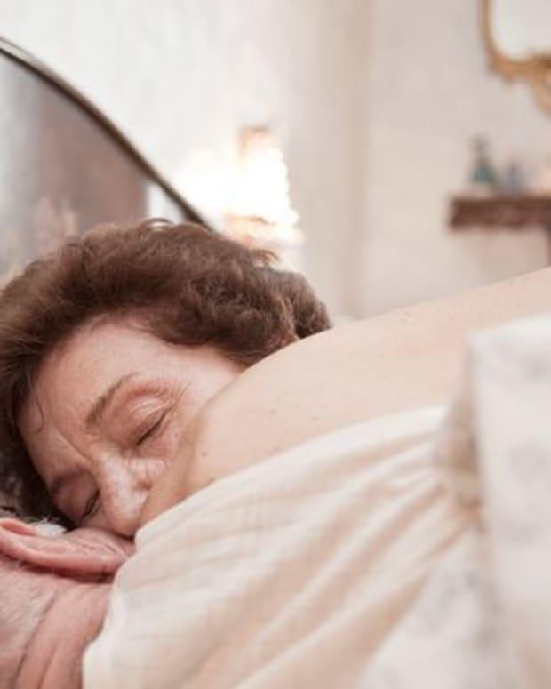 Elderly couple in bed (stock photo)