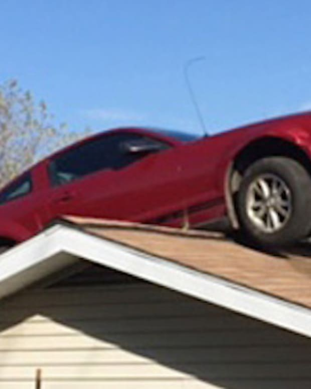 car sitting on roof of michigan home
