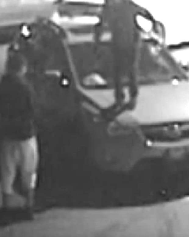 teens on surveillance video vandalizing car