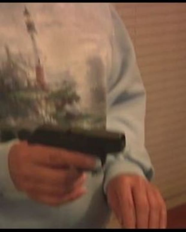 Karen Duncan and Ron Childress with guns