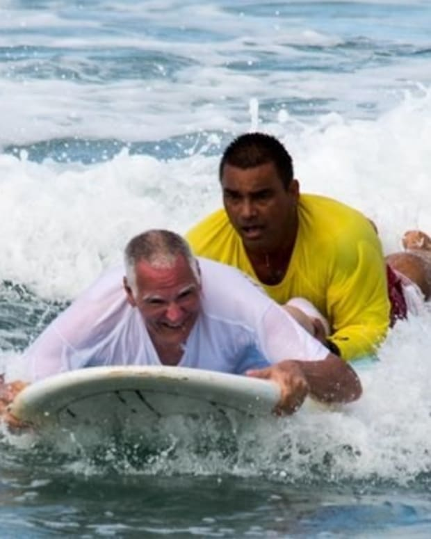 Lifeguard Goes Surfing With Paralyzed Veteran (Photos) Promo Image